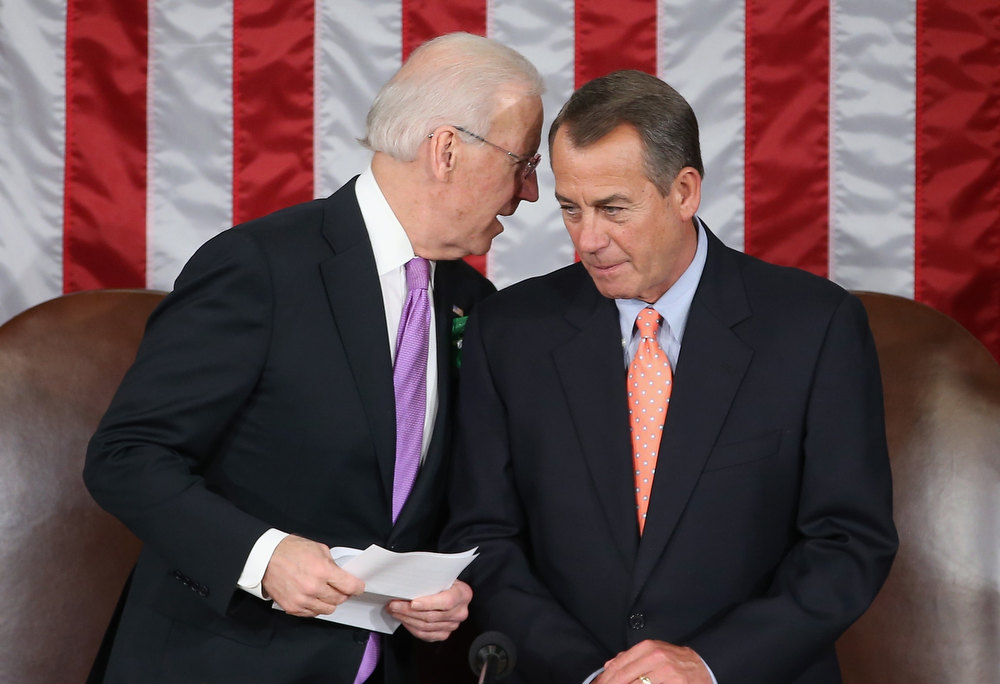 Description of . U.S. Vice President Joe Biden (L) talks with Speaker of the House Johen Boehner (R-OH) before U.S. President Barack Obama's State of the Union address February 12, 2013 in Washington, DC. Facing a divided Congress, Obama is expected to focus his speech on new initiatives designed to stimulate the U.S. economy.  (Photo by Mark Wilson/Getty Images)