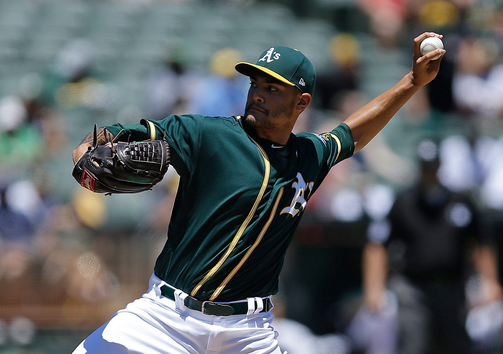 . Oakland Athletics pitcher Sean Manaea works against the Cleveland Indians in the first inning of a baseball game, Sunday, July 16, 2017, in Oakland, Calif. (AP Photo/Ben Margot)