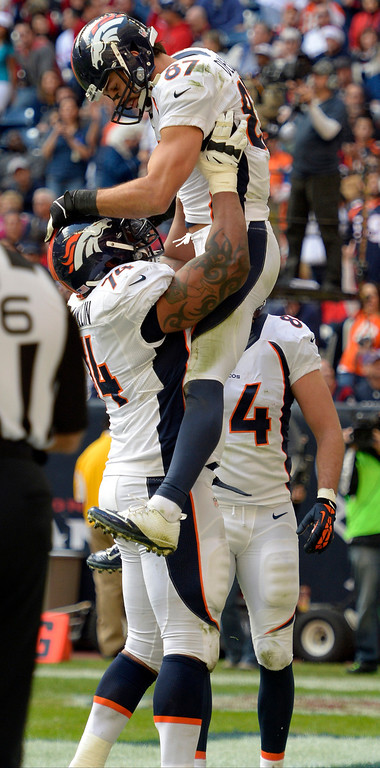 . Denver Broncos wide receiver Eric Decker (87) celebrates his 9th touchdown of the year with Denver Broncos tackle Orlando Franklin (74) during the fourth quarter against the Houston Texans December 22, 2013 at Reliant Stadium. (Photo by John Leyba/The Denver Post)