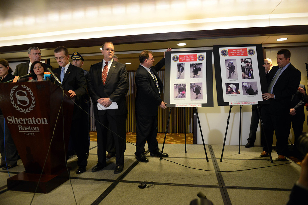 . FBI Special Agent in Charge Richard DesLauriers (L) speaks at a news conference April 18, 2013 at the Sheraton Hotel in Boston, Massachusetts. Officials today released the images of two suspects in the Boston Marathon bombing that killed three people and wounded hundreds more.  (Photo by Darren McCollester/Getty Images)