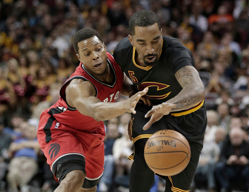 . Toronto Raptors\' Kyle Lowry, left, and Cleveland Cavaliers\' J.R. Smith battle for a loose ball in the first half of an NBA basketball game, Wednesday, April 12, 2017, in Cleveland. (AP Photo/Tony Dejak)