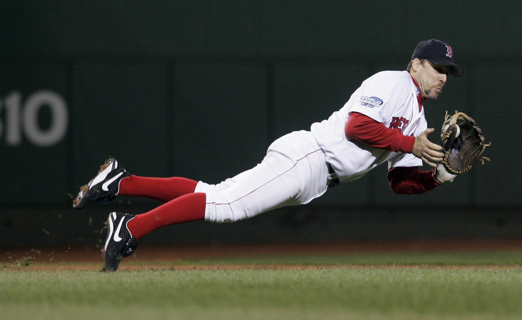 . Boston Red Sox\' Bill Mueller snags the ball and recovers to throw out St. Louis Cardinals\' Edgar Renteria in the third inning of game one of the World Series in Boston, Saturday, Oct. 23, 2004. (AP Photo/Elise Amendola)