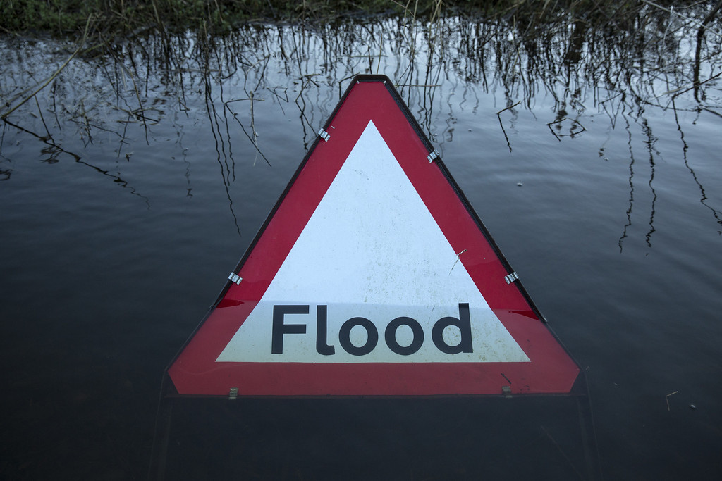 . A flood warning road sign on a partially submerged road near the river Thames on February 13, 2014 in Wargrave, England.  (Photo by Oli Scarff/Getty Images)