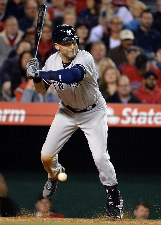 . New York Yankees\' Derek Jeter hit by a pitch in the eighth inning of a baseball game against the Los Angeles Angels at Anaheim Stadium in Anaheim, Calif., on Tuesday, May 6, 2014.  (Keith Birmingham Pasadena Star-News)