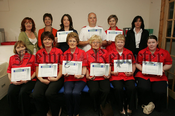 Pictured are the recieptants of NVQ level 2 Health and Social Care certificates, Gregory Tumility, Grazyna Dworaczyk, Anne Tumility, Ali Cromie, Lily McClorey, Kathleen Murphy, Kathleen Kennon and Catrina McCabe, also pictured are, Noleen Smith Head opf School NKIFHE, Tutor Grainne Magee, Lucy Daly Key Worker Provinical Care and Angela McKeever Area manager Southern Regional Area Trust. 07W35N5