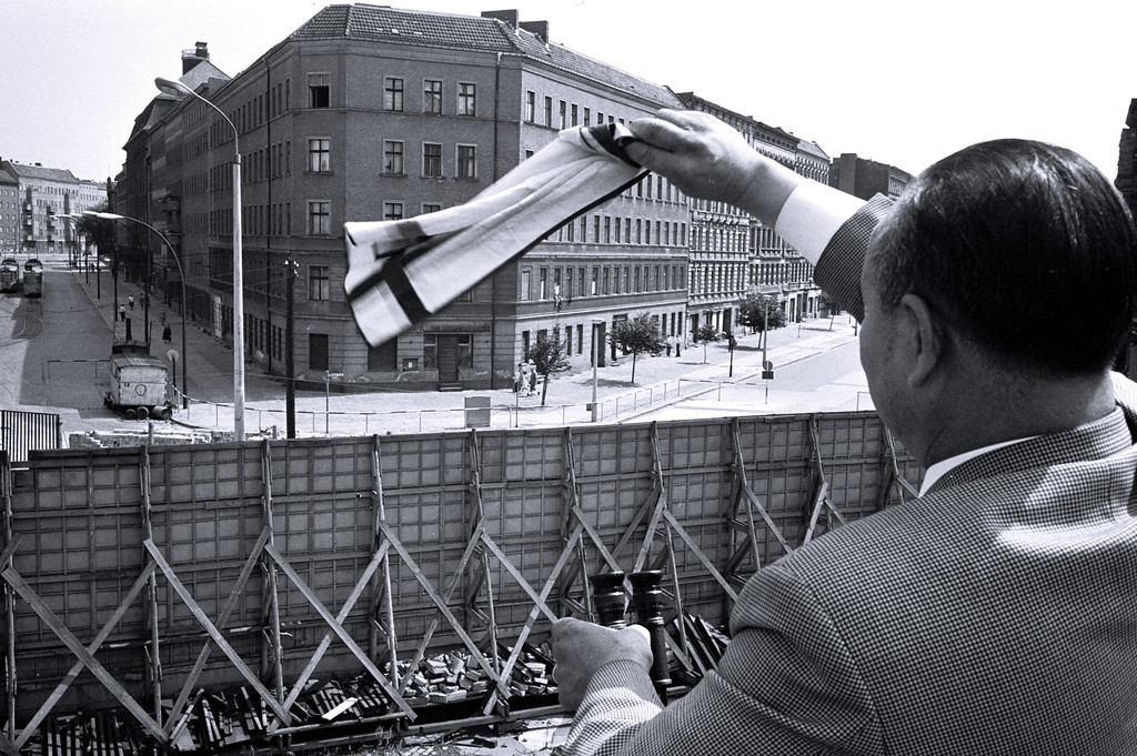 . Bernauerstrasse - people waving to their relatives on the other side of the Wall, August 1967.  (photo by NATO)