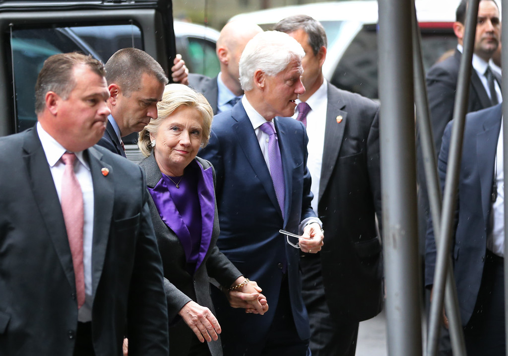 . Hillary Clinton, holding hands with her husband, former President Bill Clinton, arrives at a New York hotel to speak to her staff and supporters after losing the race for the White House, Wednesday, Nov. 9, 2016. Earlier in the day she conceded the race to Republican president-elect Donald Trump. (AP Photo/Seth Wenig)