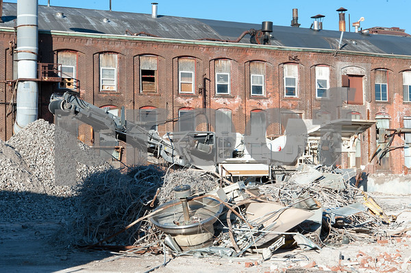 01/25/18 Wesley Bunnell | Staff The rear of partially demolished Stanley buildings on the corner of Myrtle and Curtis St.