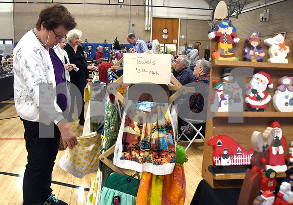 10/28/2017 Mike Orazzi | Staff Barbara Cossette looks over items for sale during the Bristol Senior Center Craft Fair on Saturday.