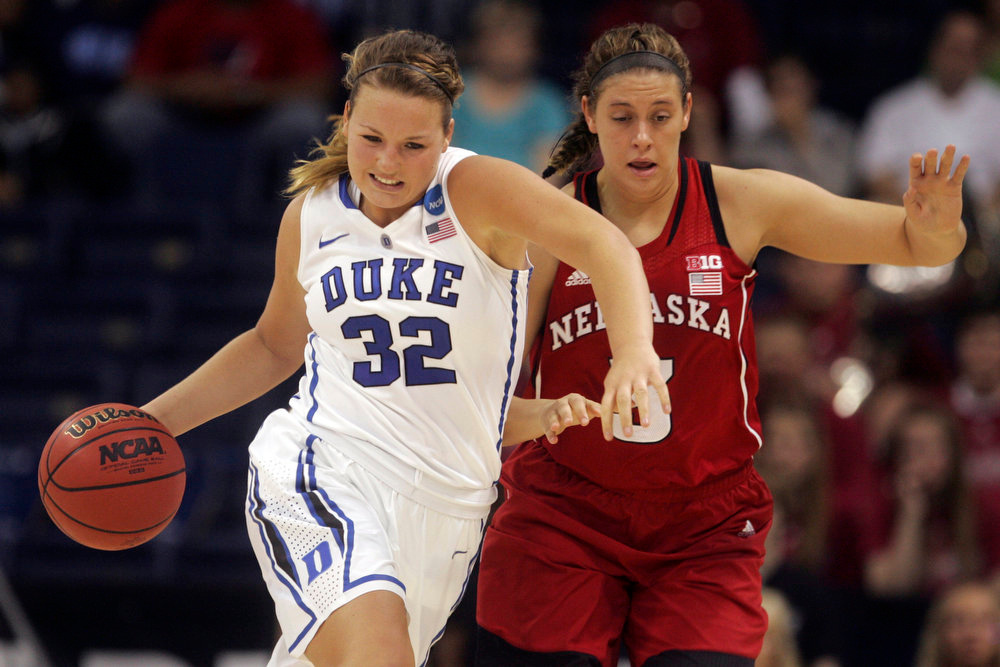 . Duke guard Tricia Liston (32) drives downcourt as Nebraska forward Hailie Sample (3) follows during the second half of a regional semifinal in the women\'s NCAA college basketball tournament, Sunday, March 31, 2013, in Norfolk, Va. Duke won 53-45. (AP Photo/Jason Hirschfeld)