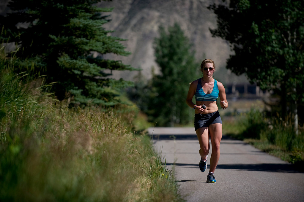 . Olympic downhill skier Mikaela Shiffrin runs a four-mile uphill run as part of her training for this year\'s Winter Olympics, in Beaver Creek Co. on July 15, 2013. (Photo By Grant Hindsley/The Denver Post)