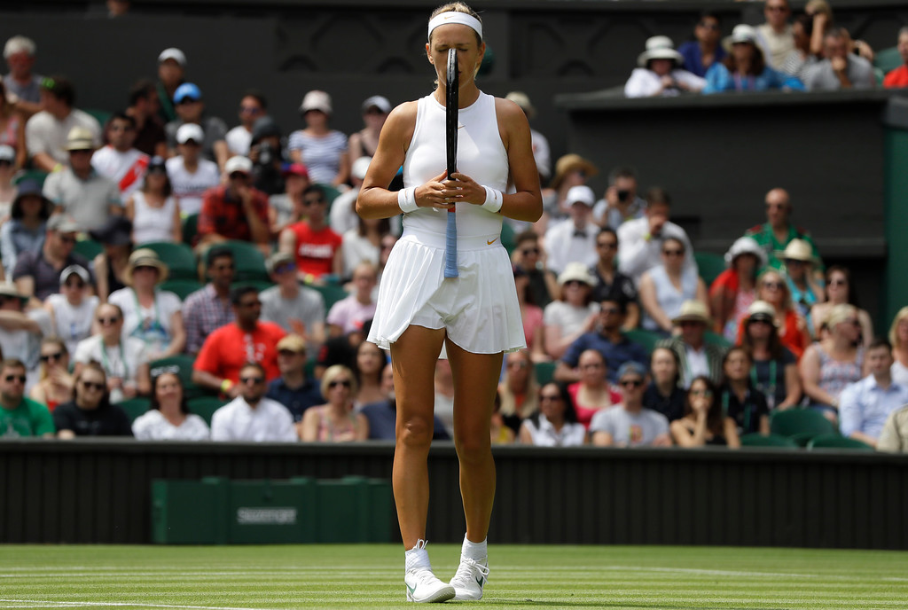 . Victoria Azarenka, of Belarus, chews on her racket after loosing a point to Czech Republic\'s Karolina Pliskova, during their women\'s singles match, on the third day of the Wimbledon Tennis Championships, in London, Wednesday July 4, 2018. (AP Photo/Kirsty Wigglesworth)
