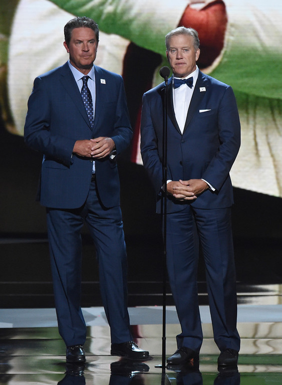 . Dan Marino, left, and John Elway present the Jimmy V award for perseverance at the ESPY Awards at Microsoft Theater on Wednesday, July 18, 2018, in Los Angeles. (Photo by Phil McCarten/Invision/AP)