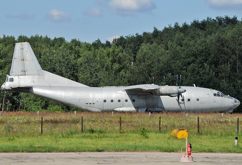 """Chkalovsky Air Base (CKL/UUMU) outside Moscow on July 25, 2008. Russian Air Force Antonov An-12BK """"18 Red"""" (cn 00347007). Painted in a standard air force overall gray colour scheme, with a faded red star on the fin. This aircraft was later sold to private owners with the new registrations RA-11379, ST-AZH and ST-KNR."""