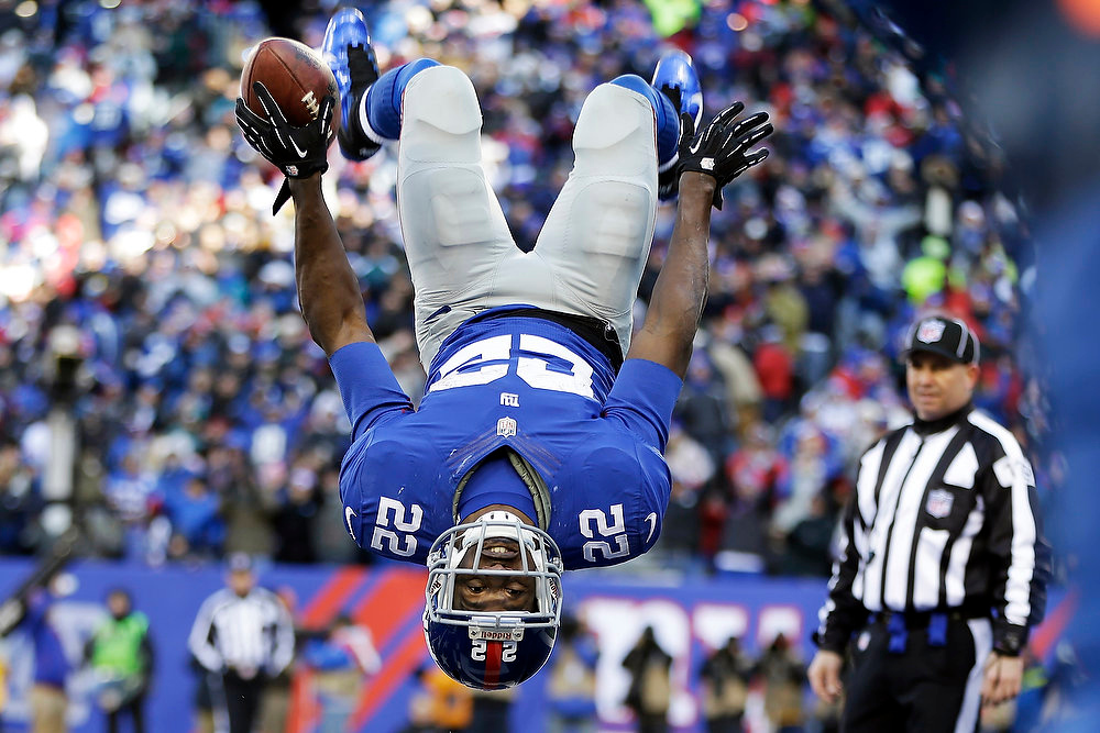 Description of . New York Giants running back David Wilson (22) flips while celebrating a touchdown during the first half of an NFL football game against the Philadelphia Eagles, Sunday, Dec. 30, 2012, in East Rutherford, N.J. (AP Photo/Kathy Willens)