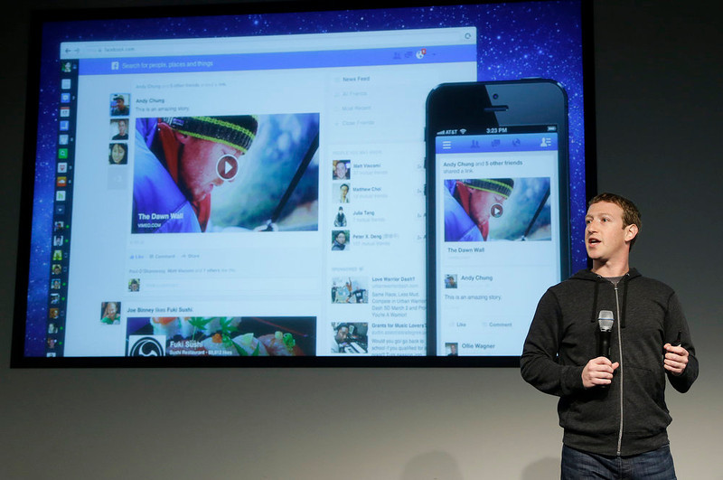 . Facebook CEO Mark Zuckerberg speaks at Facebook headquarters in Menlo Park, Calif., Thursday, March 7, 2013. Zuckerberg unveiled a new look for the social network\'s News Feed on Thursday, the place where its 1 billion users congregate to see what\'s happening with their friends, family and favorite businesses.  (AP Photo/Jeff Chiu)