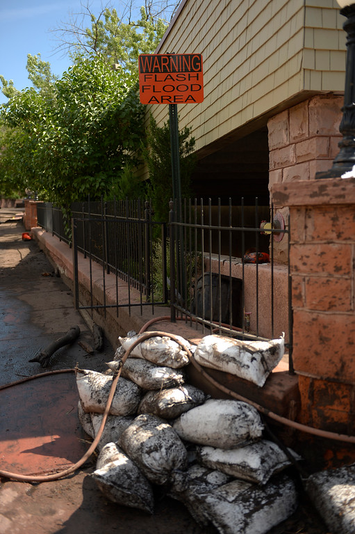 . Manitou Springs, CO. - July 02: A flash flood washed through houses, streets and businesses after a downpour over the Waldo Canyon burn scar in El Paso County July 02, 2013 Manitou Springs, Colorado. (Photo By Joe Amon/The Denver Post)