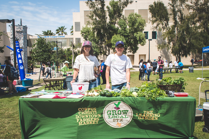 Aislynn Campbell (left), and Michelle Kish with GROW Local South Texas at the Islander Dining Farmer's Market.
