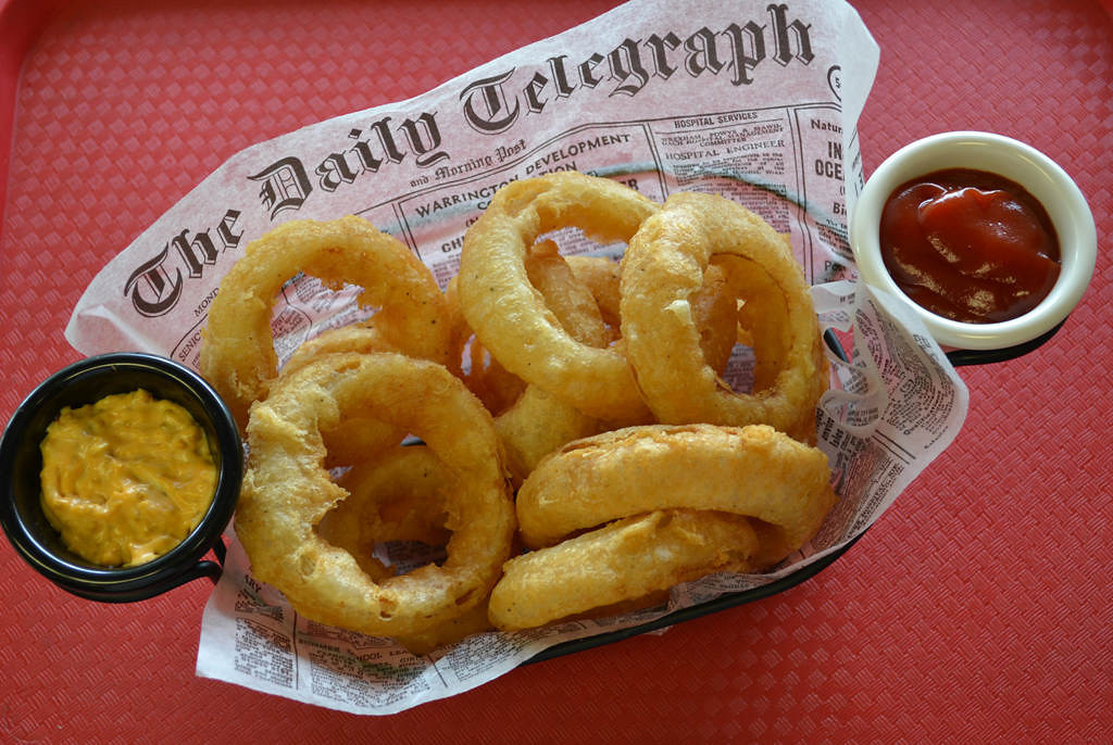 . Craft Beer Battered Onion Rings -- Thick-cut onions are dipped in Indeed Daytripper, a local craft beer, then battered, deep fried and served with a spicy beer mustard. Available at Ball Park Café, located on Underwood St., near Carnes Ave. Photo courtesy of the Minnesota State Fair.