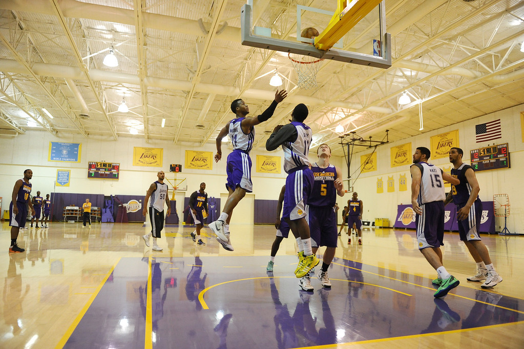 . Laker\'s Summer League practice. Laker\'s practice and media meet up with draft pick Ryan Kelly and latest signee Robert Sacre.   Photo by Brad Graverson 7-10-13