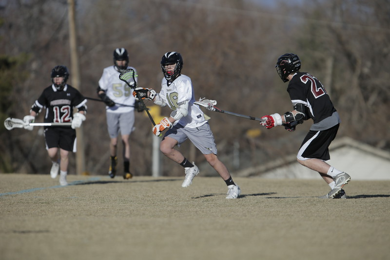 JPM0078-JPM0078-Jonathan first HS lacrosse game March 9th.jpg