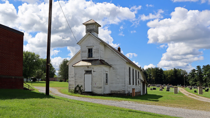 The township hall is presumably the white, former school buliding.