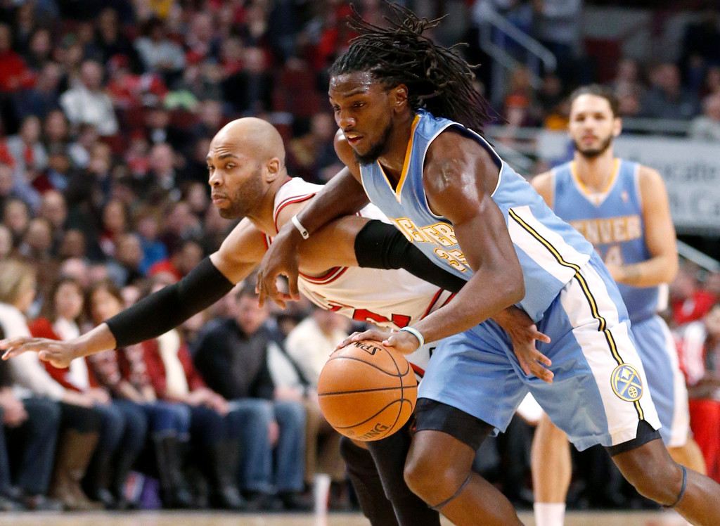 . Denver Nuggets forward Kenneth Faried, right, drives past Chicago Bulls forward Taj Gibson during the first half of an NBA basketball game Friday, Feb. 21, 2014, in Chicago. (AP Photo/Charles Rex Arbogast)