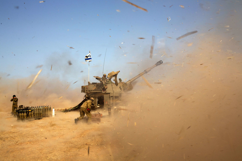 . An Israeli artillery fires a 155mm shell towards targets in the Gaza Strip from their position near Israel\'s border with the Strip on July 12, 2014. Israel pounded Gaza for a fifth day today, vowing no let-up in its air campaign to halt rocket attacks by militants which has killed more than 120 Palestinians. AFP PHOTO /MENAHEM  KAHANA/AFP/Getty Images