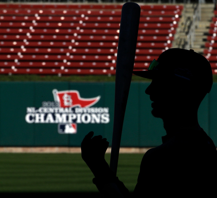 . St. Louis Cardinals right fielder Shane Robinson gets ready to bat before Game 1 of the National League baseball championship series against the Los Angeles Dodgers Friday, Oct. 11, 2013, in St. Louis. (AP Photo/David J. Phillip)