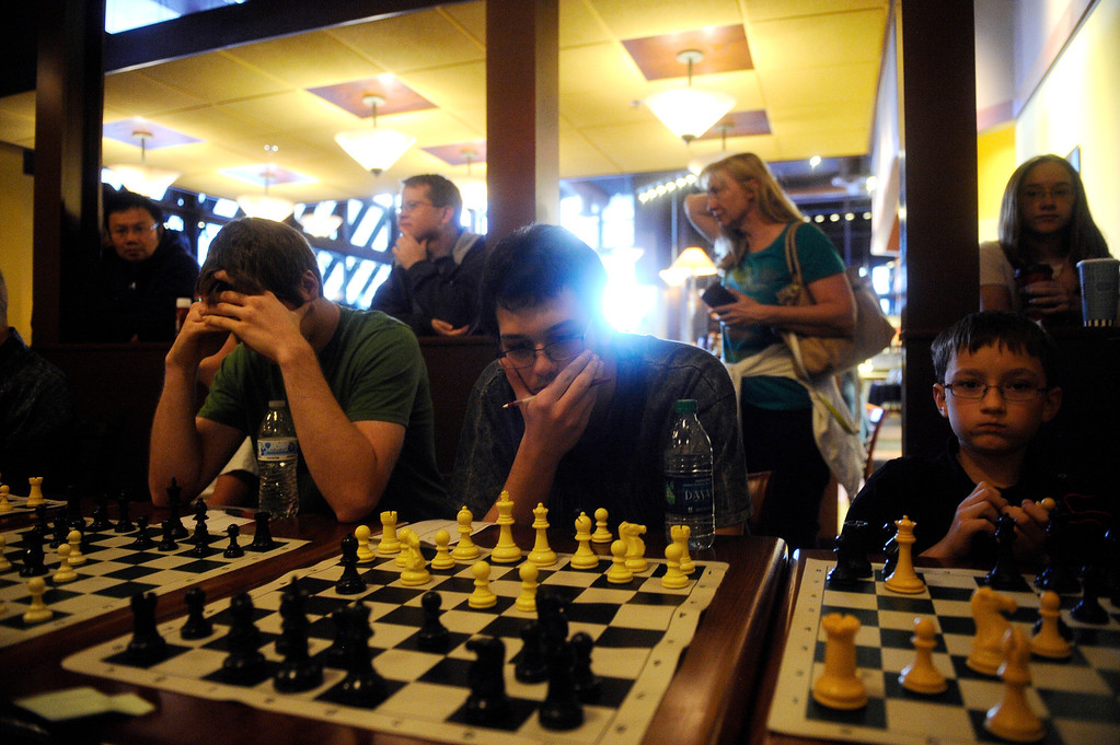 . DENVER CO: Nov. 2, 2013  Gunner Andersen, 15, considers a move during gameplay against grand chess master Timur Gareev. Andersen, one of the higher ranking players at the event, was one of 15 chess players to take on Gareev who was blindfolded during play.   (Photo By Erin Hull/The Denver Post)