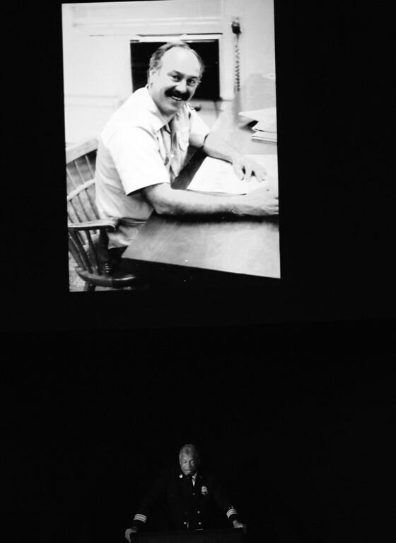. Pasadena Fire Chief, Calvin E. Wells speaks during a celebration of life service for former Pasadena Fire dept. Capt. and California State fire marshall, John Tennant at the Pasadena Civic Auditorium in Pasadena, Calif., on Wednesday, Feb. 5, 2014. (Keith Birmingham Pasadena Star-News)