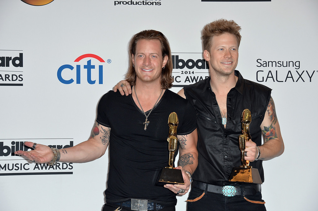 . Musicians Tyler Hubbard (L) and Brian Kelley of Florida Georgia Line, winners of Top Country Song for \'Cruise,\' pose in the press room during the 2014 Billboard Music Awards at the MGM Grand Garden Arena on May 18, 2014 in Las Vegas, Nevada.  (Photo by Frazer Harrison/Getty Images)