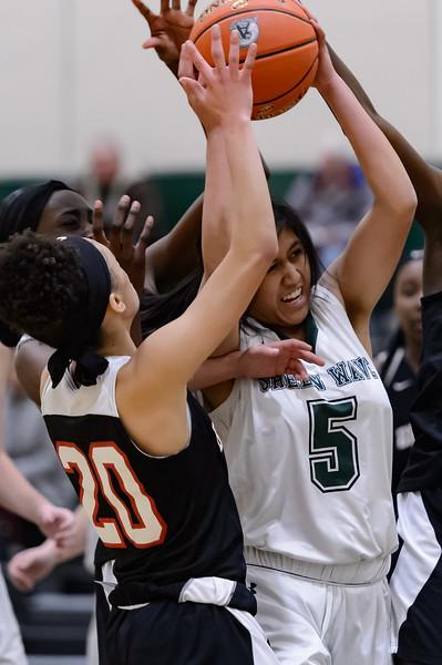 Abington High School's Erielle Maxine Amboy #5 fights for a rebound vs Brockton on 12/11/18 [Courtesy Photo/Bill Marquardt]