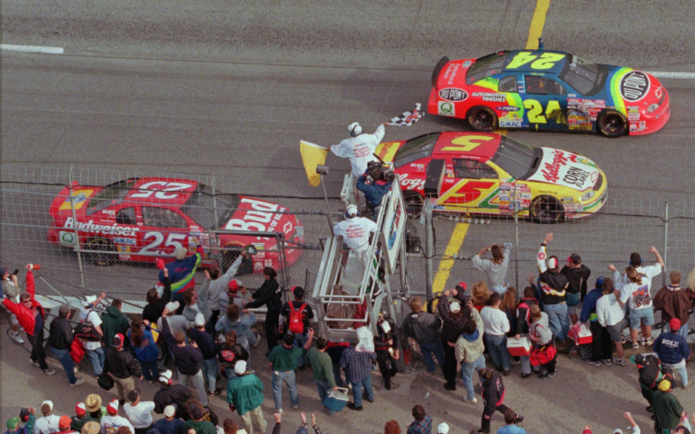Description of . Jeff Gordon, from Pittsboro, IN., driving the DuPont Refinishes Chevrolet (24) followed by Terry Labonte, from Corpus Christi, Texas, driving the Kellogg\'s Chevrolet, and Ricky Craven, from Newburgh, Maine, take the checkered flag to finish 1-2-3 during the Daytona 500 Sunday afternoon Feb. 16, 1997 at Daytona International Speedway in Daytona Beach, Fla. (AP Photo/Phil Coale)