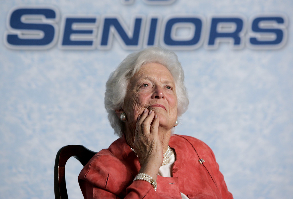 . Former first lady Barbara Bush listens to her son, President Bush, as he advances his Social Security reform proposals before a hand-picked audience at the Lake Nona YMCA Family Center in Orlando, Fla., Friday, March 18, 2005. In a state with a large population of retirees, Bush wants to assure seniors that they will continue to receive their regular government checks, while he pushes for a system of private accounts which would enable younger workers to divert a portion of their payroll taxes from Social Security deductions and into stock market investments to bankroll their retirement. (AP Photo/J. Scott Applewhite)
