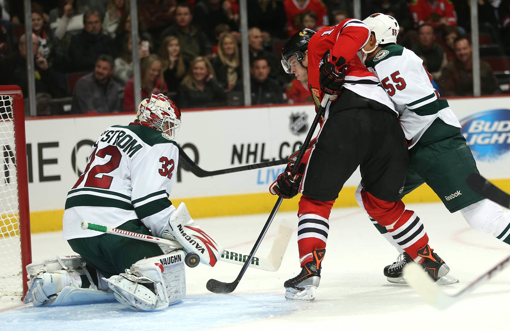 . Minnesota Wild goalie Niklas Backstrom (32) stops Chicago Blackhawks player Jeremy Morin (11) from scoring in the first period. (Chris Sweda/ Chicago Tribune/MCT)
