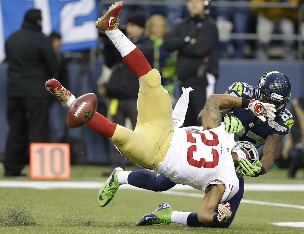 . San Francisco 49ers\' LaMichael James fumbles as he is hit by Seattle Seahawks\' Ricardo Lockette (83) on a kick off during the first half of the NFL football NFC Championship game Sunday, Jan. 19, 2014, in Seattle. The 49ers recovered the fumble. (AP Photo/Elaine Thompson)