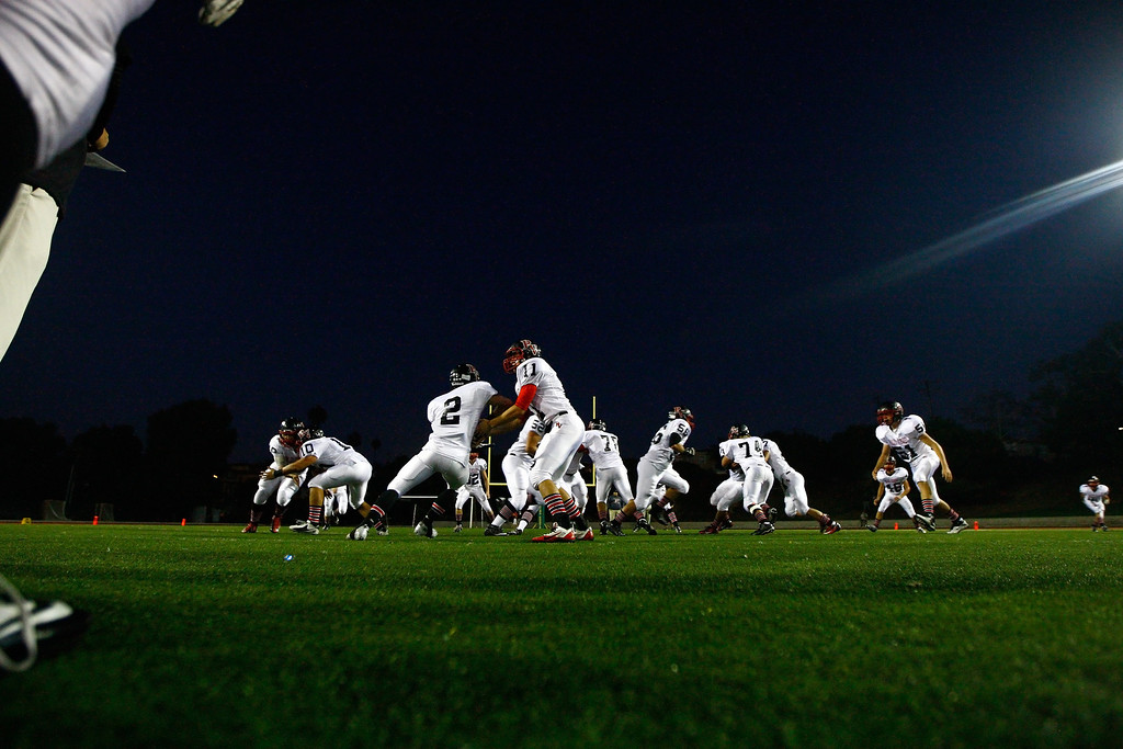 . Palos Verdes run through during warmups before kickoff against Mira Costa in a Bay League matchup at Mira Costa High School on Friday, October 18, 2013 in Manhattan Beach, Calif.  (Michael Yanow / For the Daily Breeze)