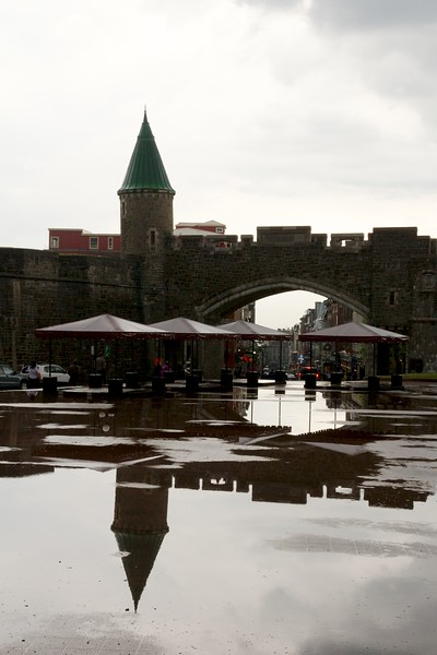 Place D'Youville on a rainy day. Quebec City. Canada. St. John's gate across the plaza.