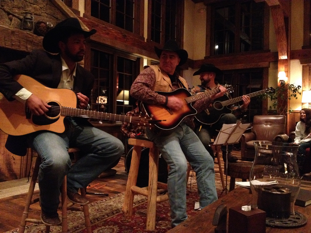 . Kaulana Naíau Aliíi Papalimu, Ben Martin and Brandon Martin, all employees at the ranch, entertain the guests during an evening performance in the Great Room. (Photo by Kyle Wagner)