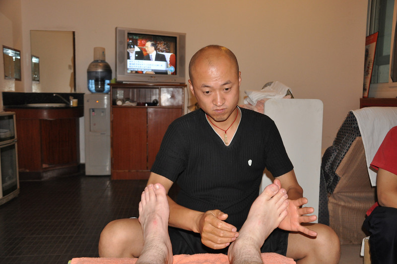 Here's the guy working on my feet.  He had a propensity for smacking my feet and shins at intervals between massaging.  I presume this was to improve blood flow.  Or maybe he has an anti-foot fetish.