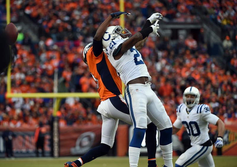. An incomplete pass intended for Emmanuel Sanders (10) of the Denver Broncos as he is pressured by Vontae Davis (21) of the Indianapolis Colts during the first half.  The Denver Broncos played the Indianapolis Colts in an AFC divisional playoff game at Sports Authority Field at Mile High in Denver on January 11, 2015. (Photo by Tim Rasmussen/The Denver Post)