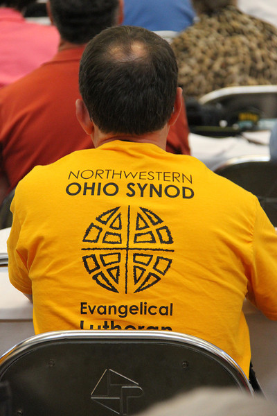 "A member from the ELCA Northwestern Ohio Synod wears a ""God's work. Our hands."" Sunday t-shirt."