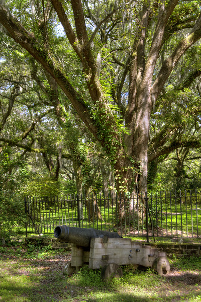 A small canon sits in front of a fence near the Legare-Waring House at Charles Towne Landing State Historic Park in Charleston, SC on Saturday, September 7, 2013. Copyright 2013 Jason Barnette