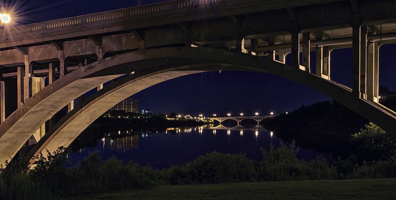 Looking under the Broadway Bridge at night towards College Bridge