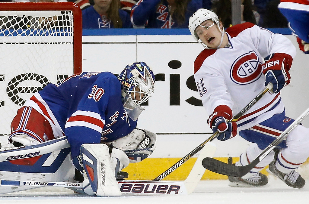 . Montreal Canadiens right wing Brendan Gallagher (11) takes a shot as New York Rangers goalie Henrik Lundqvist (30) of Sweden makes a save in the second period of Game 3 of the NHL hockey Stanley Cup playoffs Eastern Conference finals, Thursday, May 22, 2014, in New York. (AP Photo/Kathy Willens)
