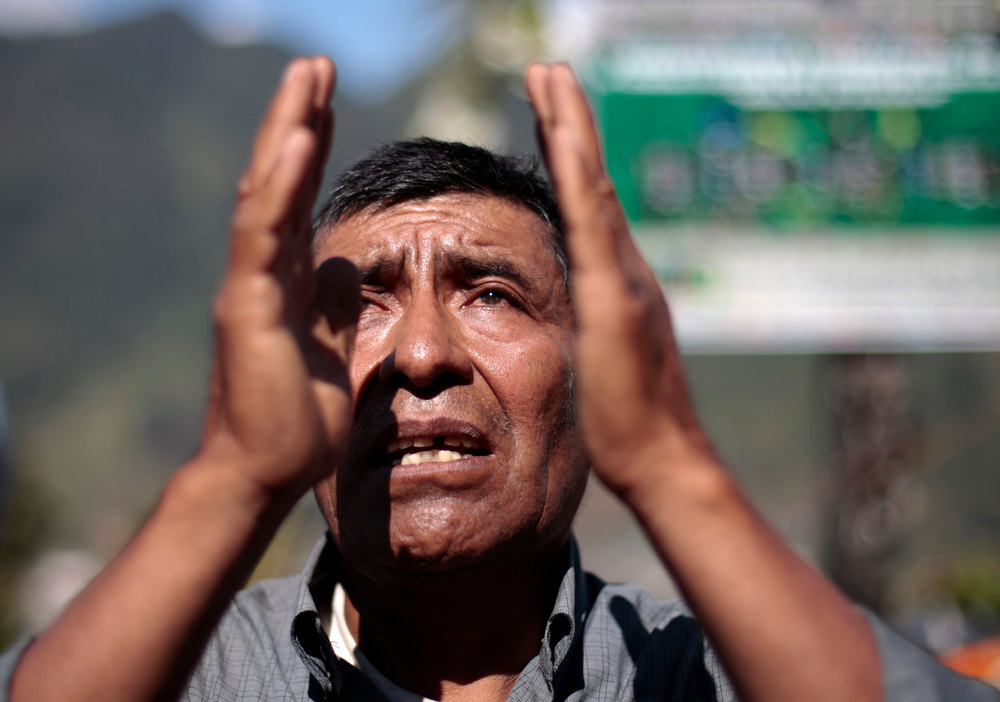 ". A man prays and participates in the pre-Hispanic mass of ""Primera Conexion\"" and \""Sincronizacion Espiritual\"" (First Connection and Spiritual Synchronization), to commemorate the 13th Baktun, outside the Chi Ixim church in Tactic, Alta Verapaz region of Guatemala, December 20, 2012. This week, at sunrise on Friday, December 21, an era closes in the Maya Long Count calendar, an event that has been likened by different groups to the end of days, the start of a new, more spiritual age or a good reason to hang out at old Maya temples across Mexico and Central America. The Chi Ixim church is a sacred Mayan site.  REUTERS/Jorge Dan Lopez"