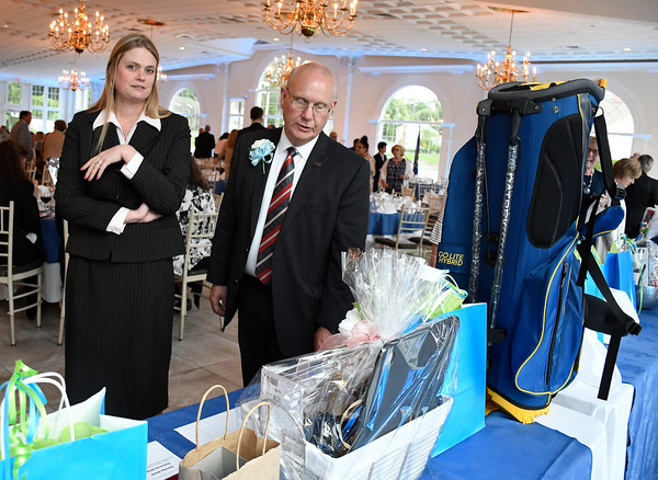 6/6/2018 Mike Orazzi | Staff Corrin D'Amato and Mark DiVenere at the silent auction during the 129th Annual Bristol Chamber of Commerce Awards Dinner held at the Aqua Turf Club in Southington Wednesday night.