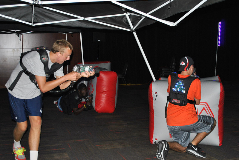 Students participate in a game of laser tag.