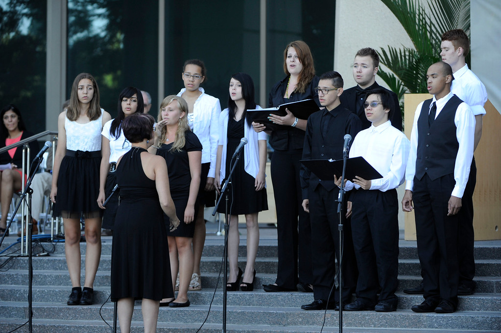 . AURORA, CO - JULY 20:  The Hinkley High School Choir sings �Amazing Grace� at the 7/20 Day of Remembrance 2013 at the Aurora Municipal Center Saturday morning, July 20, 2013. Over 200 people attended the service in honor of the 12 people killed and over 60 people injured in last years Aurora theater shooting. The service included prayer, songs and speeches from local officials and the Governor of Colorado, John Hickenlooper. (Photo By Andy Cross/The Denver Post)